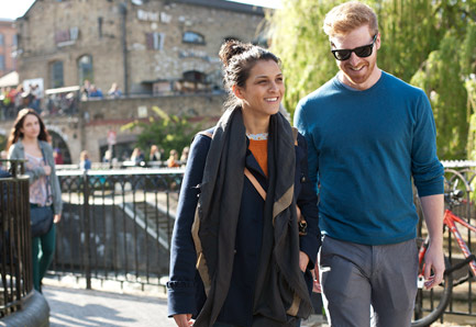 Young couple walking past Camden Lock