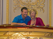 A couple enjoying their private box at the Novello Theatre in London's West End