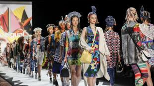 Models walking down catwalk