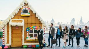Commuters queue for a bite of Gingerbread House