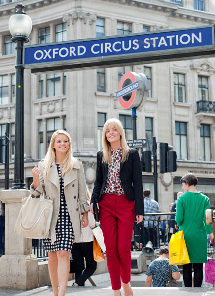 Two women leaving Oxford Circus tube station