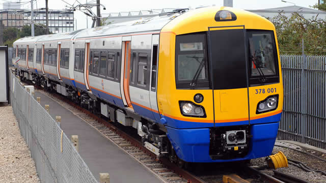 Overground train arriving at a station transport for london