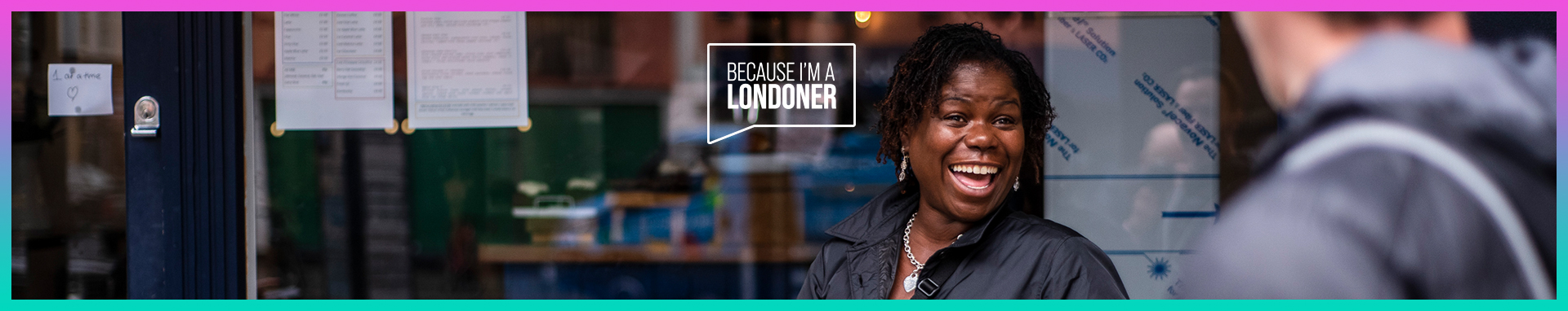 """A lady stands in front of a shopfront, she's smiling as a man walks past in the foreground. A logo worded """"Because I'm a Londoner"""" is overlaid on the image, inside a speech bubble."""