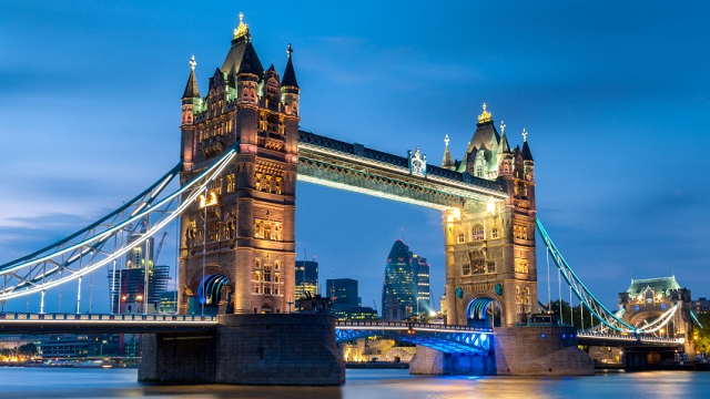 A view of illuminated Tower Bridge after dark.
