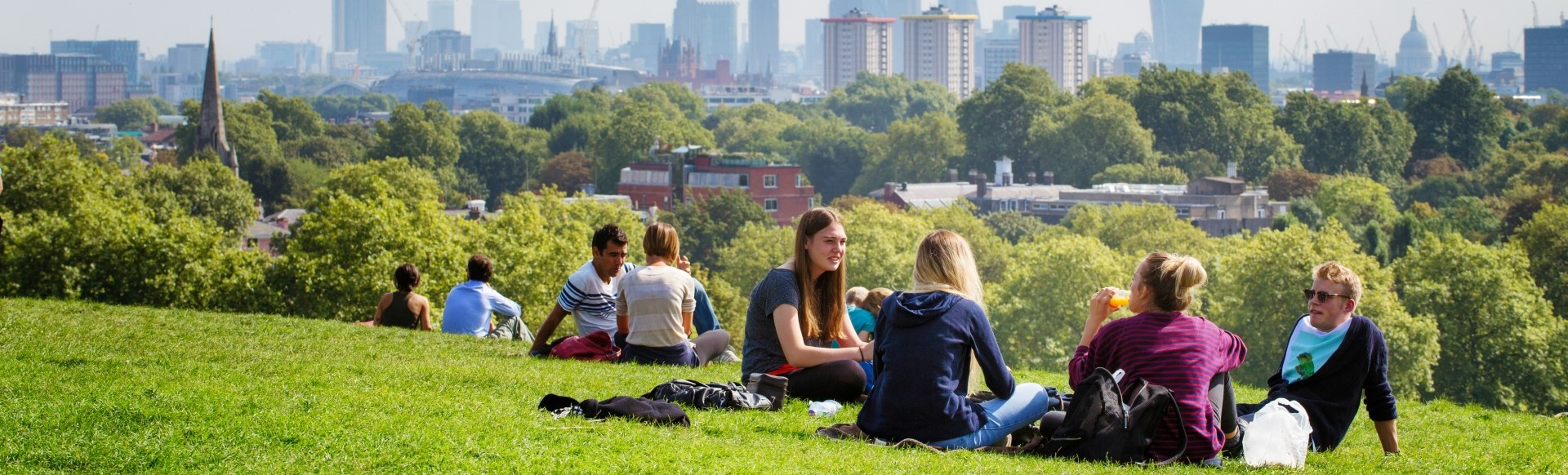 People sitting down in a park