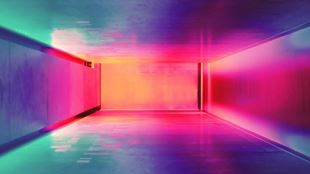 Corridor lit in bright pink, purple and green colours.