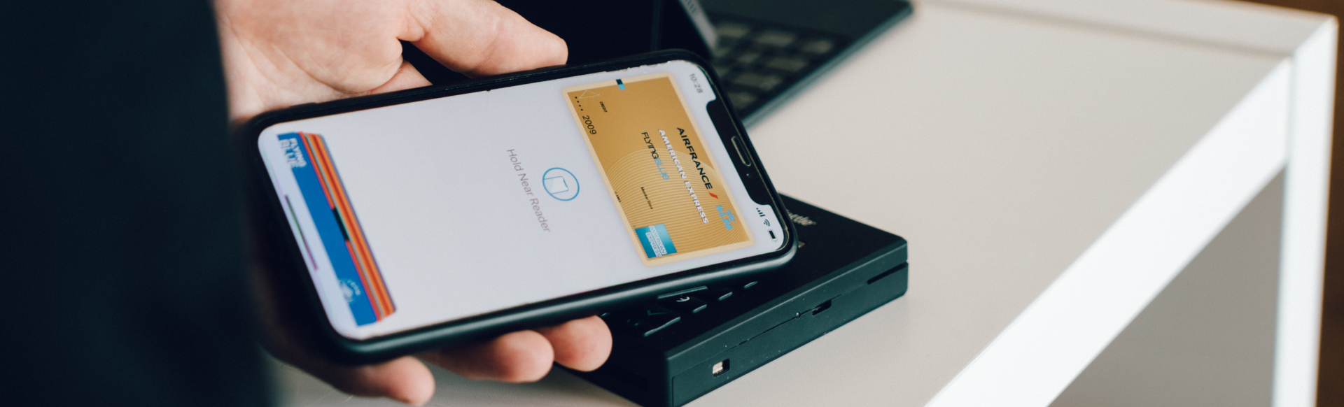 Person showing a boarding pass on their black Android phone.