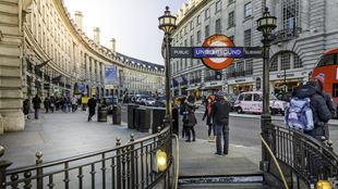 Piccadilly Circus tube stop sign and beginning of Regent Street