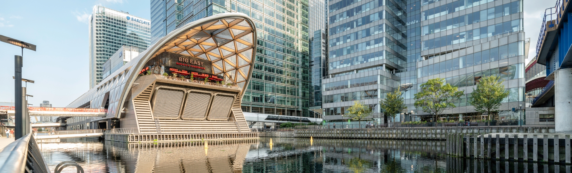 A trendy street food eatery among the modern buildings in Canary Wharf, London.