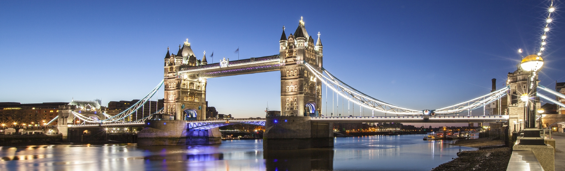 Riverside view of Tower Bridge on a clear night.