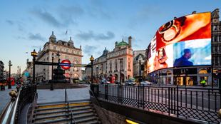 The bright lights of Piccadilly Circus as seen from the steps of the Piccadilly tube station.