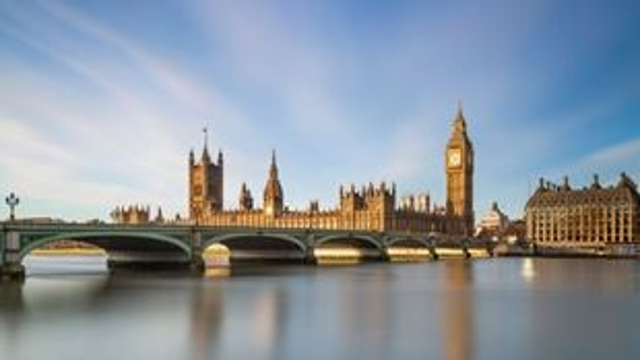 Big Ben, Houses of Parliament and Westminster Bridge in golden sunlight in Westminster.