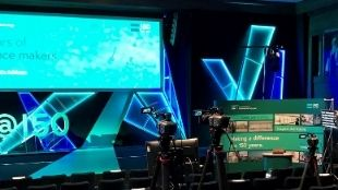 Close up of studio equipment and technology at IET London: Savoy Place in a dark room with turquoise screens and media lights.