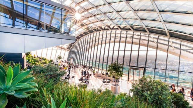 Top floor at the Sky Garden, with a great view over London and the cafe area with green plants.