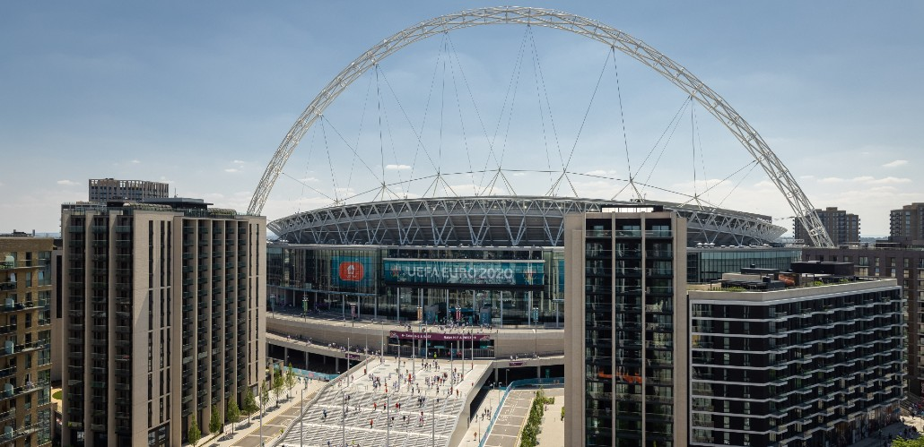Exterior view of Wembley Stadium and crowds arriving to watch a game during the UEFA EURO 2020 tournament.