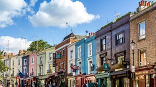 Colourful houses and antique shop fronts in Notting Hill.
