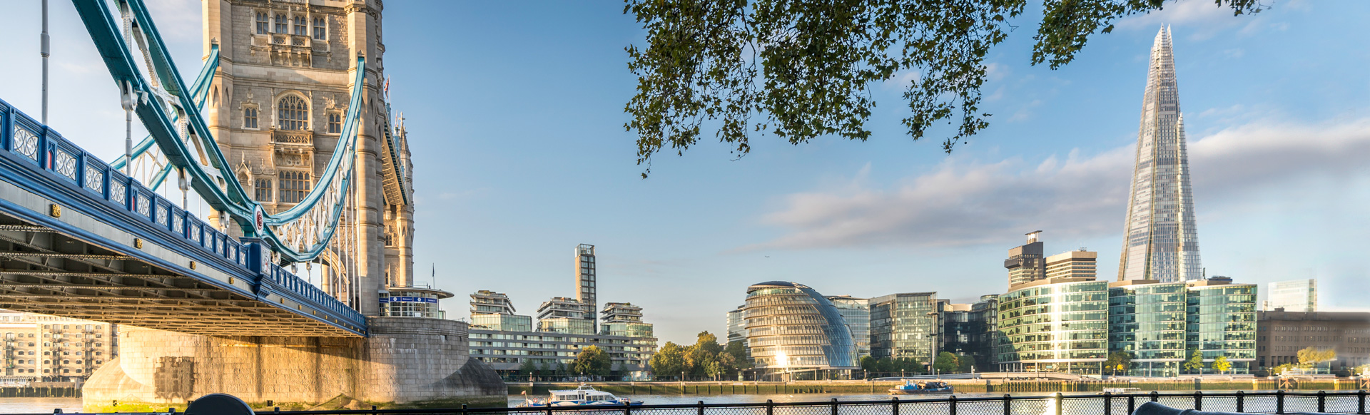 View of Tower Bridge, the Shard, the cityhall and the Thames riverside during golden hour.