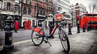 Santander bicycle in London standing alone on the pavement