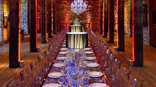 Dining table arrangement with clear chairs in the Tower of London, Historic Royal Palaces.
