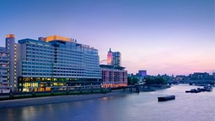 Sea Containers building at sunset with the riversinde in front.