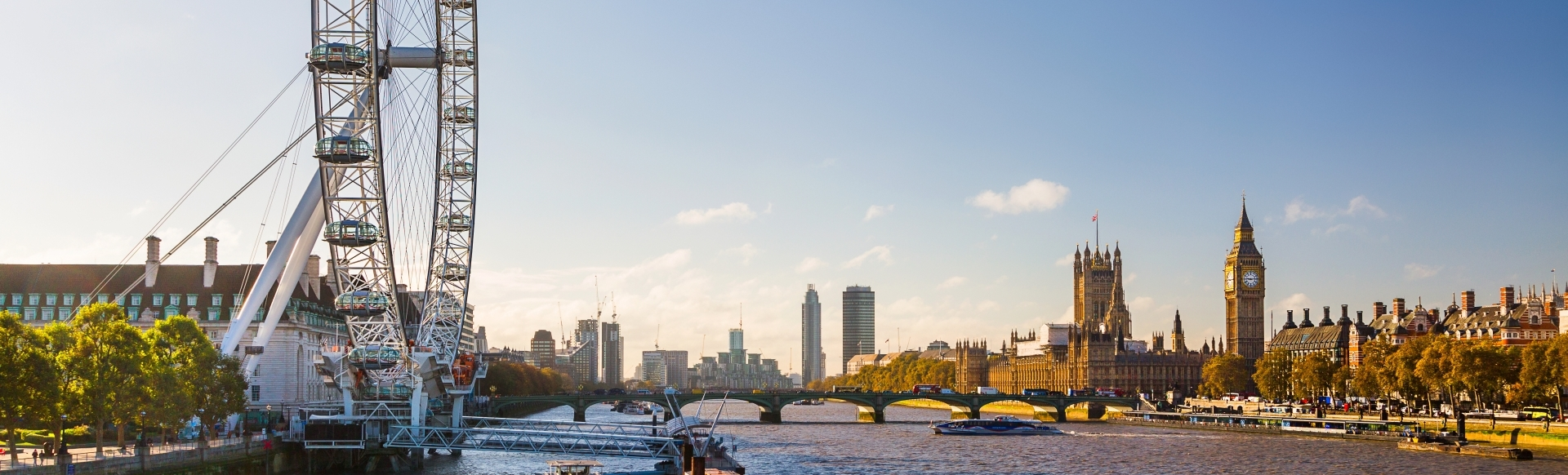 The river Thames on a sunny day, with Westminster in the background.