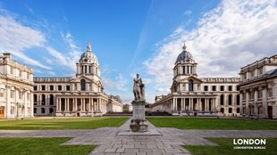 Greenwich Royal Naval College front view with a statue in the centre.