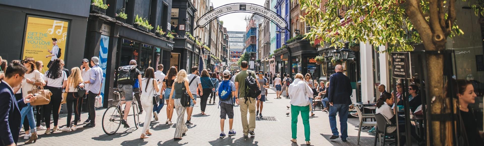 People walking past shops on London's Carnaby Street.