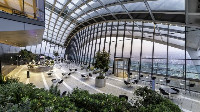 A leafy view over London from inside the top floor of Sky Garden.
