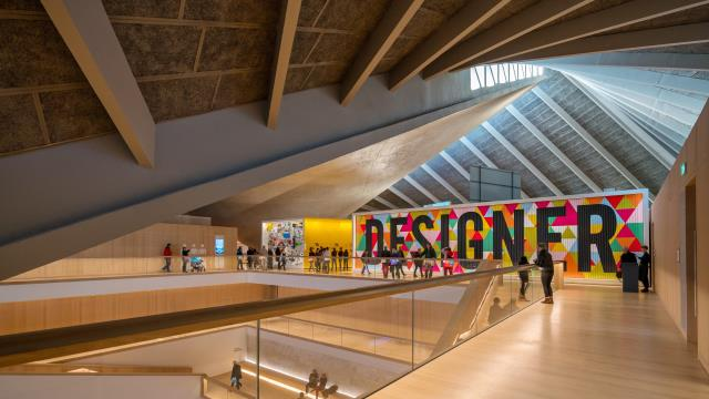 The interior of the Design Museum in London showing the angular ceiling and large multicoloured Designer mural at the top of the main staircase