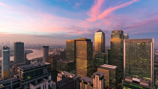 Panoramic view of Canary Wharf with beautiful pinks sunset sky.