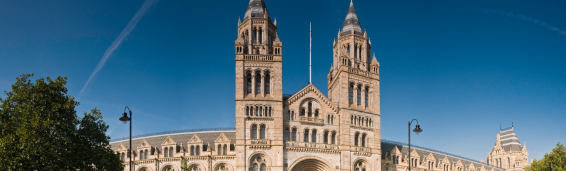 The main entrance of the Natural History Museum in London on a beautifully sunny day.