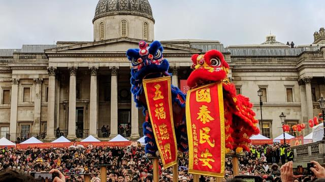 Two Chinese dragons, one blue, one red, celebrate Chinese New Year in Trafalgar Square