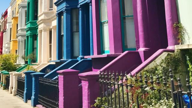 A row of rainbow-painted large terrace houses