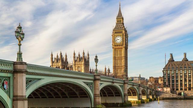 Views of Big Ben and the palace of Westminster on a sunny day in London.