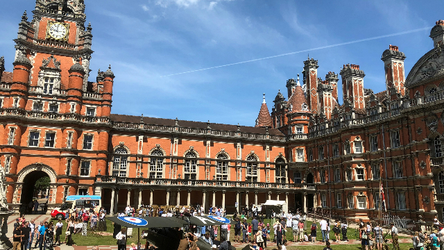 The grandiose red brick façade of the Royal Holloway university photographed on a sunny day in London.