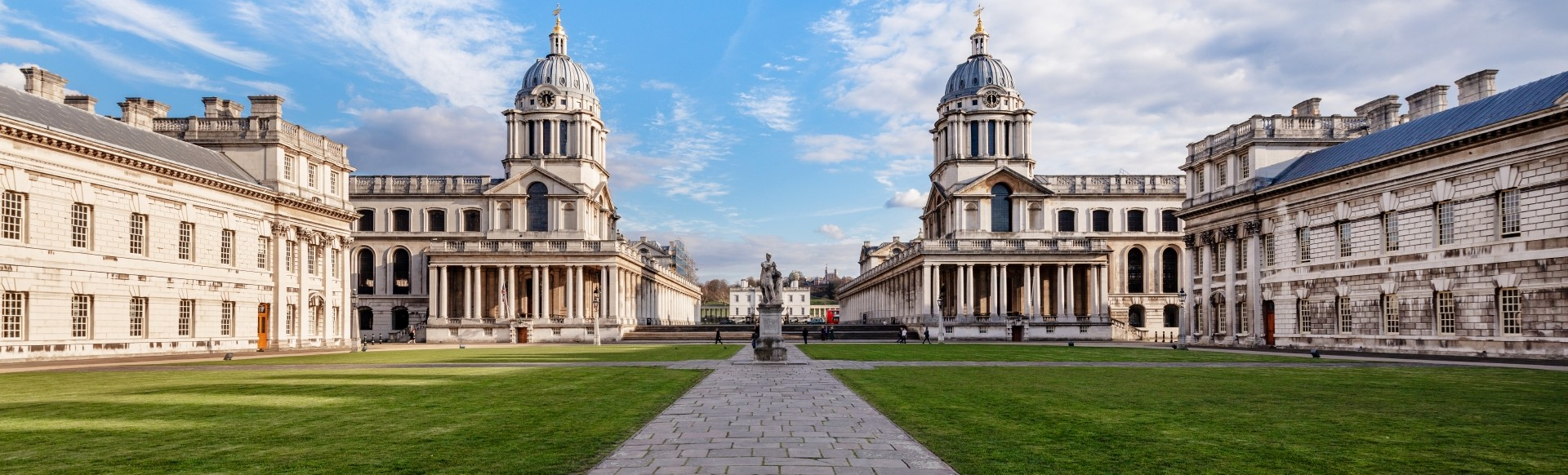 The Old Royal Naval College building on a sunny day in Greenwich.