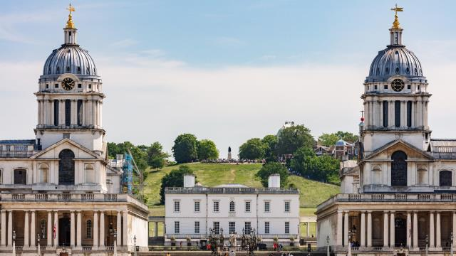 The twin domes of the Old Royal Naval College with Greenwich Park in the background