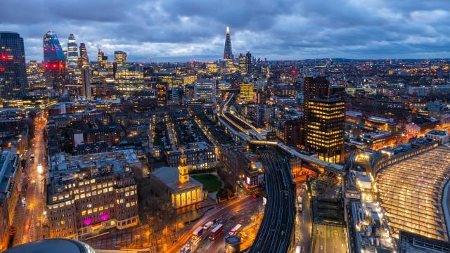 A panoramic view of London's skyline after sunset.