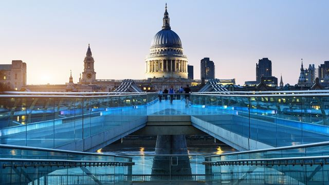 Lit up St Paul's Cathedral at sunset, seen from Millennium Bridge.