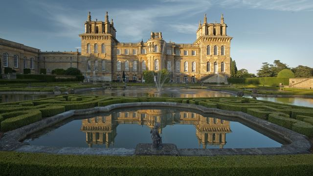 Blenheim Palace in Oxford with reflection in water pool in the gardens