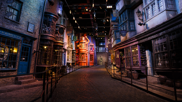 The Diagon Alley set from the Harry Potter film series, set in a nigh time atmosphere.