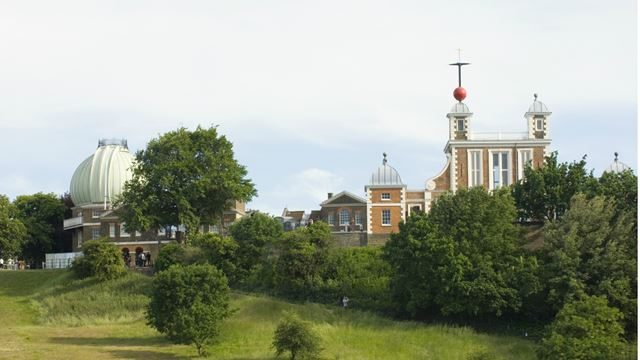 View of the Royal Observatory Greenwich surrounded by greenery.