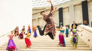 Dancers in colourful Diwali dress perform on the steps of the British Museum.