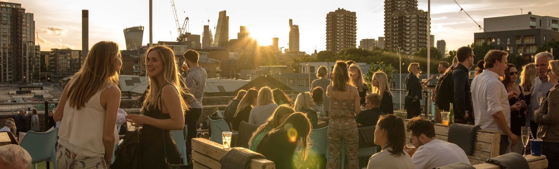 People are socialising in a rooftop bar