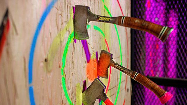 Three axes hitting a multi-coloured target
