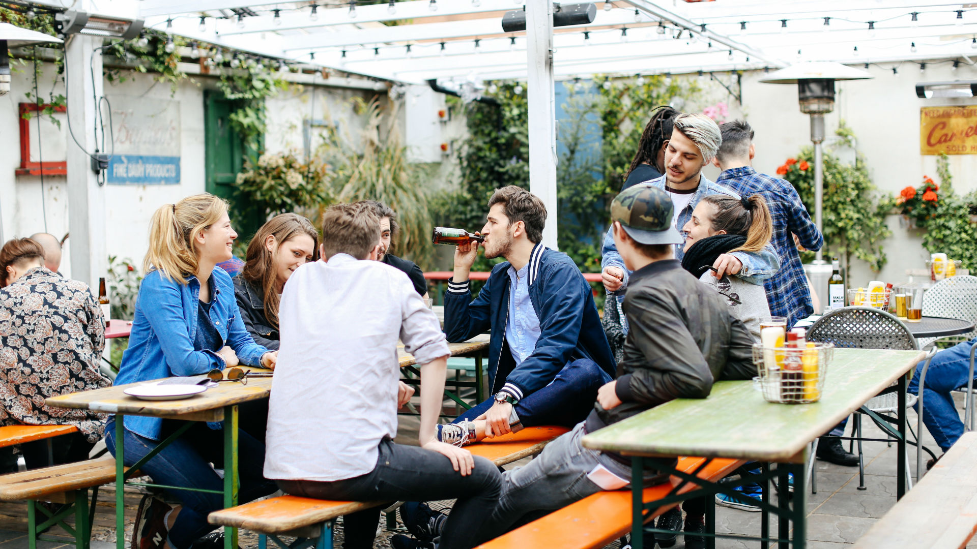 A group of customers enjoy a chat in the Crown & Shuttle's beer garden. Image courtesy of Crown & Shuttle.