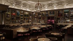 Pictures hang on the wall inside of Berners Tavern restaurant in London.