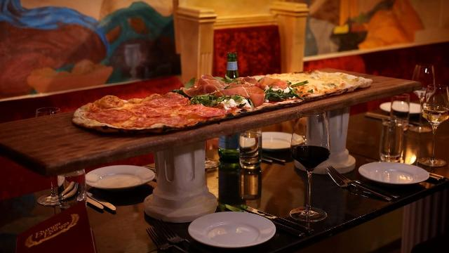 Plate of pizza on restaurant table