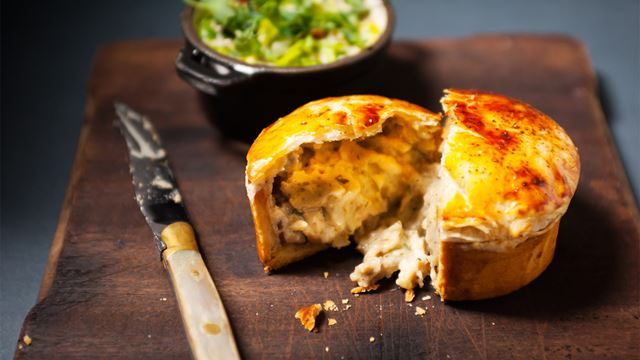 One of Corrigan's Mayfair's chicken and mushroom pies is broken open to reveal the filling.