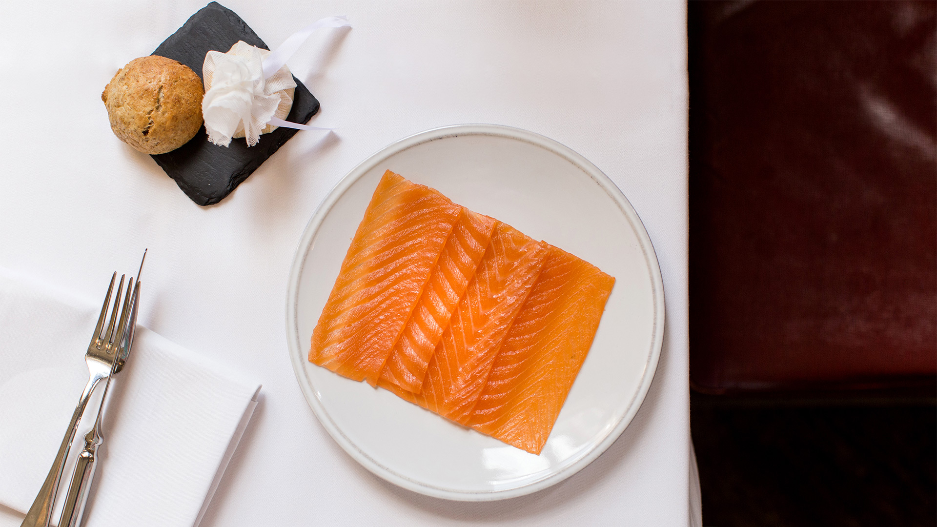 An aerial view of smoked salmon on a plate at The Gilbert Scott.